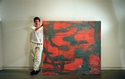 """Louise Fishman with her painting """"A Stranger,"""" in New York in 2000. Fishman, a widely exhibited artist who imbued her Abstract Expressionist paintings and other works with elements of feminism and gay and Jewish identity, died on July 26, 2021, in Manhattan. She was 82. The New York Times"""