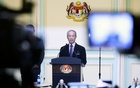 FILE PHOTO: Malaysia's Prime Minister Muhyiddin Yassin speaking during his cabinet announcement in Putrajaya, Malaysia March 9, 2020. REUTERS/Lim Huey Teng/File Photo