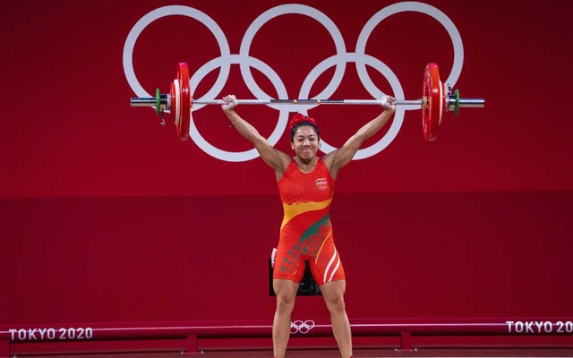 Mirabai Chanu of India in the women's 49-kilogram class weightlifting event at the postponed 2020 Tokyo Olympics in Tokyo on July 24, 2021. She won gold in the event. (Doug Mills/The New York Times)