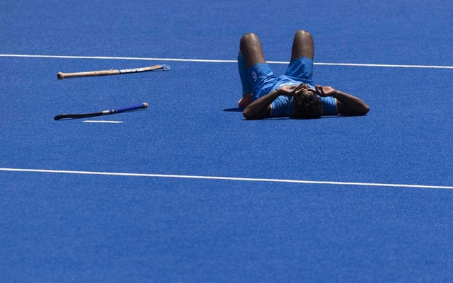 Surender Kumar of India on the playing field after loosing their men's field hockey semifinal match against Belgium at the postponed 2020 Tokyo Olympics in Tokyo on Aug. 3, 2021. Aside from a string of men's hockey wins generations ago, India has won only one other gold in its Olympic history, in shooting in 2008. (Alexandra Garcia/The New York Times)