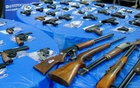 Guns are displayed after a gun buyback event organized by the New York City Police Department (NYPD), in the Queens borough of New York City, US, on June 12, 2021. REUTERS