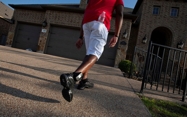 Kendrick Fulton, who was released to home confinement due to the coronavirus disease (COVID-19) pandemic, finishes his first walk since he had knee surgery in Round Rock, Texas, US, Apr 8, 2021. He wears an ankle monitor that he must charge nightly in order to comply with the terms of his release. REUTERS