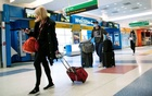 Passengers arrive on a flight from London amid new restrictions to prevent the spread of coronavirus disease (COVID-19) at JFK International Airport in New York City, U.S., December 21, 2020. REUTERS