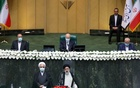 Iran's new President Ebrahim Raisi takes the oath during his swearing-in ceremony at the parliament in Tehran, Iran, August 5, 2021. WANA via REUTERS