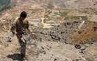 A Lebanese army member holds the remains of Israeli ammunition as he stands near the damage in the aftermath of Israeli air strikes in Marjayoun, near the border with Israel, Lebanon Aug 5, 2021. REUTERS