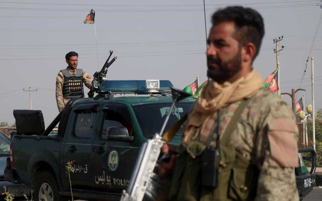 Afghan security forces keep watch at a checkpoint in the Guzara district of Herat province, Afghanistan July 9, 2021. REUTERS