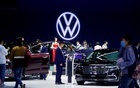 People visit the Volkswagen booth during a media day for the Auto Shanghai show in Shanghai, China April 19, 2021. REUTERS