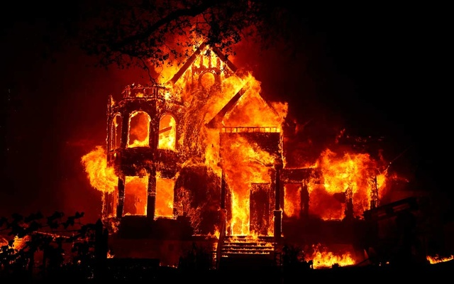 FILE PHOTO: A home is seen fully engulfed in flames during the Glass Fire in St Helena, California, US September 27, 2020. REUTERS