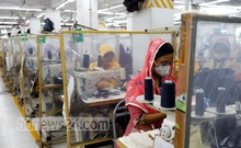 Men and women working at an apparel factory in Dhaka's Tejgaon. To protect the workers from virus, the authorities have separated them from each other by erecting polyethene-made cells. Photo: Kazi Salahuddin