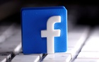 A 3D-printed Facebook logo is seen placed on a keyboard in this illustration taken March 25, 2020. REUTERS