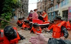 China cities declare rain 'red alerts' as flood death toll hits 21