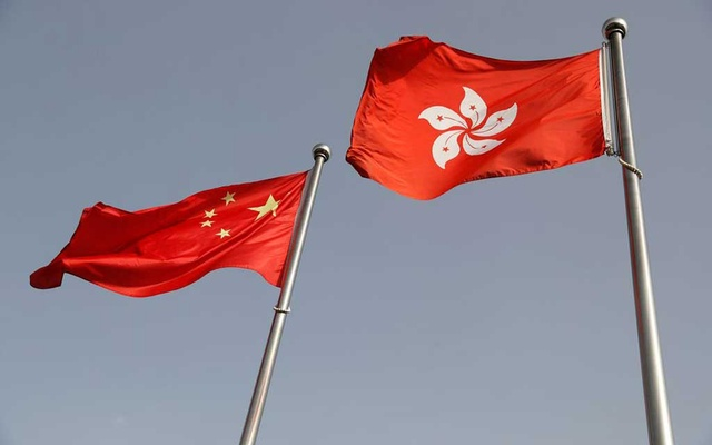 The Chinese and Hong Kong flags flutter at the office of the Government of the Hong Kong Special Administrative Region, ahead of a news conference held by Hong Kong Chief Executive Carrie Lam, in Beijing, China June 3, 2020. REUTERS
