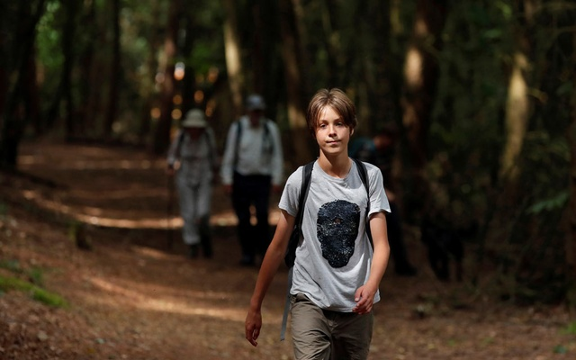 Jude Walker, 11, during his 210 miles (340 km) walk from Yorkshire to London over 21 days to raise awareness for 'the zero carbon campaign' petition, which calls for the government to implement a Carbon Tax, in Milton Keynes, Britain August 10, 2021. REUTERS