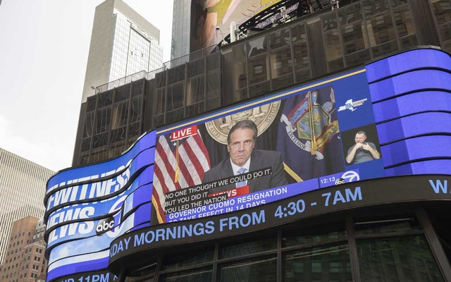 A video of New York Gov Andrew Cuomo is shown on a display at New York's Times Square as he delivers remarks that included his resignation announcement, Aug 10, 2021. Carl Heastie, the speaker of the New York State Assembly, said the body would end its investigation of Gov Cuomo when his resignation takes effect later this month. Benjamin Norman/The New York Times