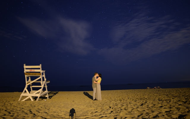 An undated photo provided by Amanda Gefter of she and fiancé Justin Smith during his early morning proposal on a beach. (Amanda Gefter via The New York Times)
