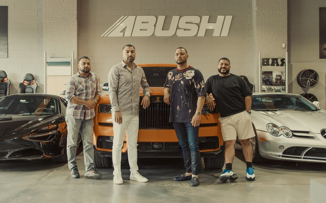 The Abushi brothers from left, Fadi, Abed, Yas and Rosco at their luxury and exotic automotive facility in New York, Aug. 9, 2021. For certain status chasers, the Abushi brothers take car customisation to the next level — with luxury price tags to match. (Braylen Dion/The New York Times)