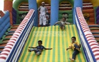 Children are all smiles as they take a ride with their parents at DNCC Wonderland in Shyamoli on Thursday, Aug 19, 2021 after the reopening of the amusement centres, tourist spots and community centres following a long shutdown over the coronavirus pandemic. Photo: Kazi Salahuddin Razu