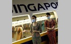 Cabin crew speak to participants during a tour of the Singapore Airlines Training Centre in Singapore November 21, 2020, as part of a series of initiatives to re-engage customers who have not been able to travel due to the coronavirus. REUTERS