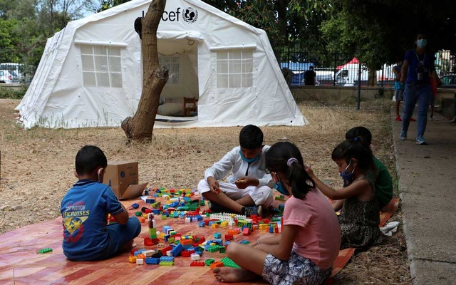 Children play outside a UNICEF tent put in place to provide psychosocial support to people affected by a massive explosion in Beirut's port area, Lebanon August 20, 2020. Picture taken August 20, 2020. REUTERS/Mohamed Azakir/File Photo