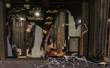 A defaced beauty shop window display in Kabul, Afghanistan, Aug 22, 2021. A Taliban spokesman urged that women should stay home, at least for now. Why? Because some of the militants have not yet been trained not to hurt them, he explained. (Victor J Blue/The New York Times)