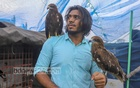 An intimacy develops between Rafid Hoque Swad and sick or injured kites at his rooftop sanctuary. He frees the birds after their recovery. Photo: Asif Mahmud Ove