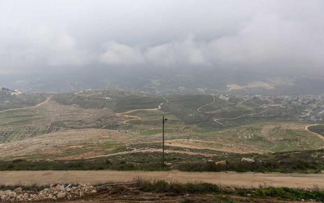 The Israeli settlement of Yitzhar, left, and the Palestinian village Urif, right, in the West Bank, Feb 25, 2020. The New York Times