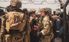 US service members provide assistance during an evacuation at Hamid Karzai International Airport in Kabul, Afghanistan, August 22, 2021. Staff Sgt. Victor Mancilla/US Marine Corps/Handout via REUTERS