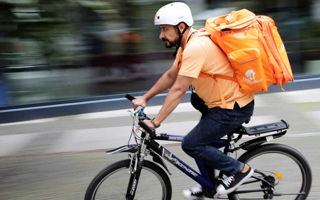 Former Afghan Communication Minister Sayed Sadaat rides a bicycle for his food delivery service job with Lieferando in Leipzig, Germany, Aug 26, 2021. REUTERS/Hannibal Hanschke