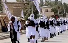 Taliban fighters march in uniforms on the street in Qalat, Zabul Province, Afghanistan, in this still image taken from social media video uploaded August 19, 2021 and obtained by REUTERS