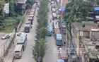 Buses are parked on one side of Ceramic Road in Dhaka Mirpur, hampering traffic daily. Photo: Asif Mahmud Ove
