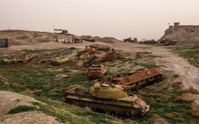 Derelict Russian tanks on hilltop base overlooking Kunduz, Afghanistan, that was captured in 2015 by the Taliban, March 7, 2018. The end of the United States' longest war was unceremonious — the wind blowing trash across the single airstrip of Kabul international airport, Afghans standing outside the gates still hoping in vain for evacuation, the Taliban firing victoriously into the night sky. The New York Times