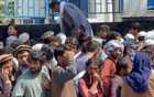 New era for Afghanistan starts with long queues, rising prices