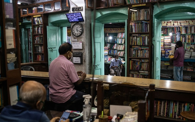 Das Gupta Books, founded in 1886 near the tram tracks in Kolkata, India, on July 20, 2021. The few tram riders left say the 140-year-old system makes sense for a city of 15 million struggling with pollution and overcrowding, but many trips now are more nostalgic than necessary. (Rebecca Conway/The New York Times)