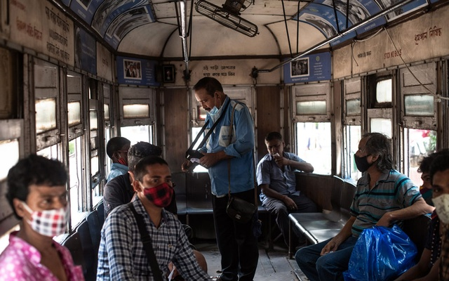 Passengers aboard a tram in Kolkata, India, on July 20, 2021. The few tram riders left say the 140-year-old system makes sense for a city of 15 million struggling with pollution and overcrowding, but many trips now are more nostalgic than necessary. (Rebecca Conway/The New York Times)