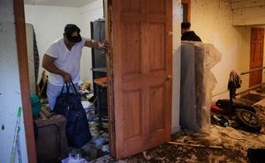 Ricardo Garcia salvages what he can from his water-damaged basement apartment in Brooklyn on Thursday, Sept 2, 2021. The New York Times