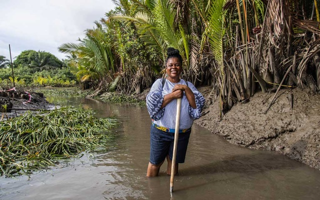 Martha Agbani visits a mangrove plantation she and an all-woman work are planting in an area of the Niger Delta ravaged by oil industry pollution, in Yorla, Nigeria, May 3, 2021. agazie Emezi/The New York Times