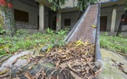 Fallen leaves have gathered on a rusty slide at the playground of T&T High School in Dhaka's Motijheel during the long shutdown over the coronavirus pandemic. Photo: Asif Mahmud Ove