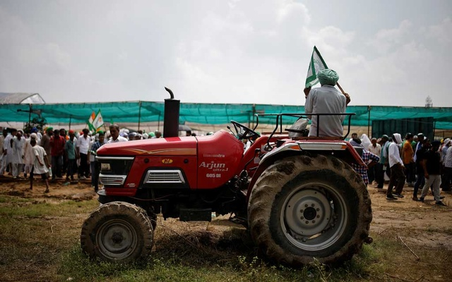 A farmer sits on a tractor as he attends a Maha Panchayat or grand village council meeting as part of a protest against farm laws in Muzaffarnagar in the northern state of Uttar Pradesh, India, Sept 5, 2021. REUTERS/Adnan Abidi