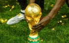 World Cup - Final - France v Croatia - Luzhniki Stadium, Moscow, Russia - July 15, 2018 General view of the trophy as France celebrate after winning the World Cup REUTERS/Kai Pfaffenbach
