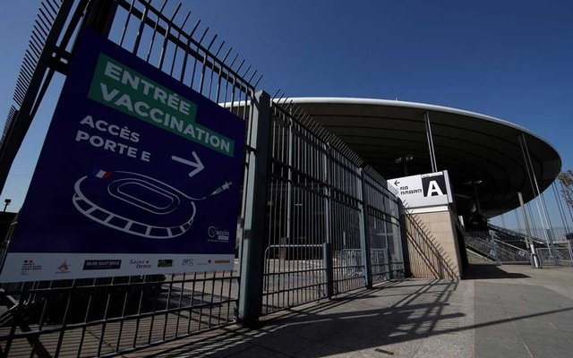An information sign is seen outside the Stade de France stadium which prepares to turn into a mass vaccination center in Saint-Denis near Paris as part of the coronavirus disease (COVID-19) vaccination campaign in France, March 31, 2021. REUTERS/Gonzalo Fuentes