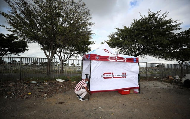 A healthcare worker sets up a mobile clinic in Gugulethu township near Cape Town, South Africa, March 26, 2021. REUTERS
