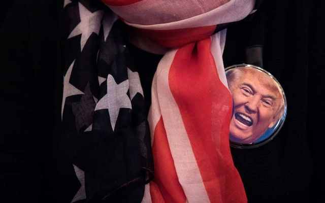 A button featuring the face of then presidential candidate Donald Trump during a campaign rally at the Giant Centre in Hershey Pa, Nov 4, 2016. The New York Times