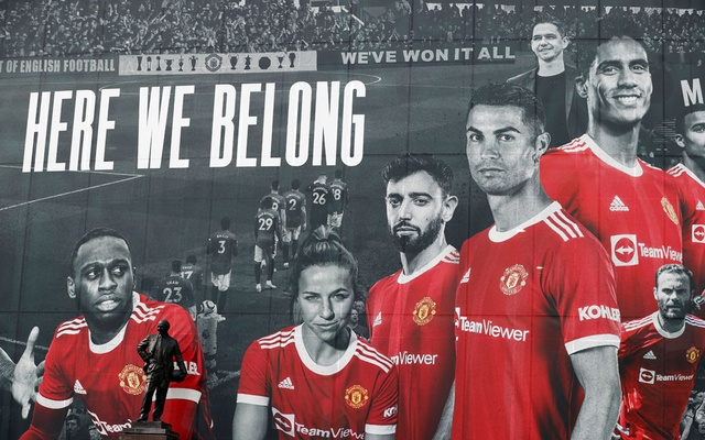 Football - A picture of Cristiano Ronaldo with teammates is displayed on the outside of Old Trafford - Old Trafford, Manchester, Britain - September 9, 2021. Reuters