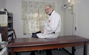 Dr Joseph Kramer sits in the office of his now-closed pay-what-you-can practice in Manhattan's Lower East Side, Feb 15, 1996. Chester Higgins Jr./The New York Times