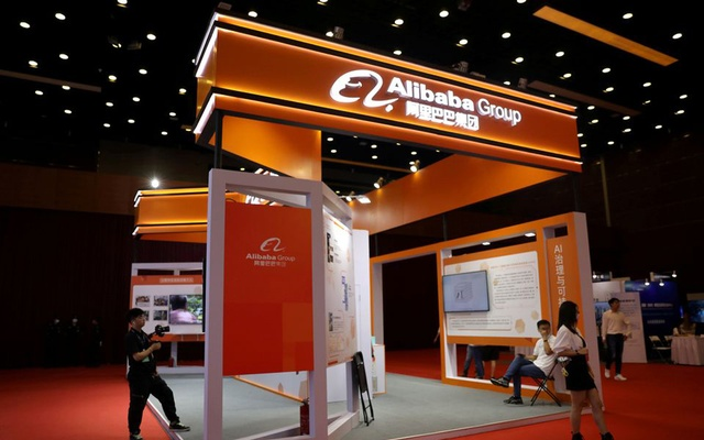 People are seen at a booth of Alibaba Group at an exhibition during China Internet Conference, in Beijing, China, July 13, 2021. REUTERS/Tingshu Wang