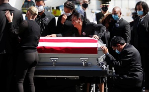 Family members react as the remains of Marine Corps Sgt Johanny Rosario Pichardo, who was among 13 US service members killed in the airport suicide bombing in Afghanistan's capital Kabul, arrive at Logan international airport in Boston, Massachusetts, US, September 11, 2021. Reuters