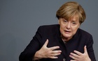 German Chancellor Angela Merkel addresses a session of the German lower house of parliament, the Bundestag, in Berlin, Germany Nov 25, 2015. REUTERS/Fabrizio Bensch