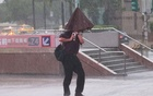 A man walks in strong wind and rain caused by Typhoon Chanthu in Taipei, Taiwan, September 12, 2021. REUTERS