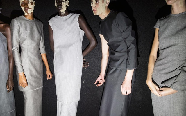 Models present looks at the Thom Browne spring 2022 fashion show in New York, Sept 11, 2021. The New York Times