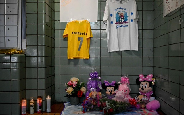 A makeshift memorial for 7-year-old Julissia Batties, who was found unconscious with a head injury, in the lobby of where she lived at the Mitchel Houses in the Bronx on Wednesday, Aug 11, 2021. Legacy Beauford, an infant, was one of two young boys in New York who the police believe were recently killed by their mothers' partners. The case follows the death in August of a 7-year-old-girl, Julissia Batties, who was fatally beaten after being reunited with her birth mother. (Desiree Rios/The New York Times)
